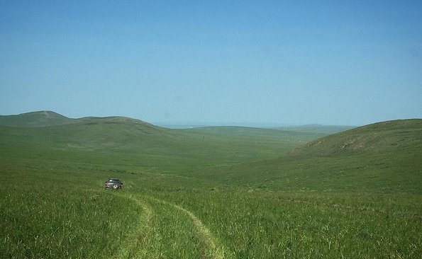 Venturopoly driving across Mongolian steppe no fences